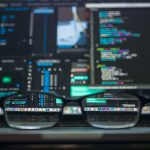 Glasses in front of data on screen
